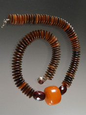 "This magnificent necklace features natural brown-toned horn wheels, two large faceted transparent cherry amber beads from my personal collection, a spectacular 1"" x 1-1/2"" antique opaque butterscotch amber wheel.  25"""