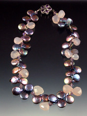 A showstopper with fabulous color, dramatic dimensions, and amazing quality!  A very limited quantity of 14-16mm high-luster peacock pearls with raw chalcedony teardrops, lilac Swarovski crystals, and a sterling amethyst flower clasp. 17-/2""