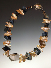 "A huge faceted Brazilian topaz is the dramatic focal point for a stunning collar of Grade AAA rare South African Pietersite (filled with natural patterns of black, blue, gray, and brown) spaced w champagne biwa pearls and 14.  17""  ONLY TWO!"
