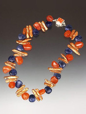 Colorful blue sodalite, carnelian, sienna stick pearls and sterling spondylus clasp necklace.