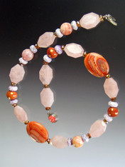 A dramatic collage featuring shades and shapes with fire agate.