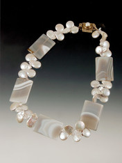 A striking collar featuring elaborately patterned gray agate slices spaced with silver pearls --super cool!