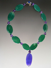 Vibrant green agate ovals featured in a free-form amethyst pendant.