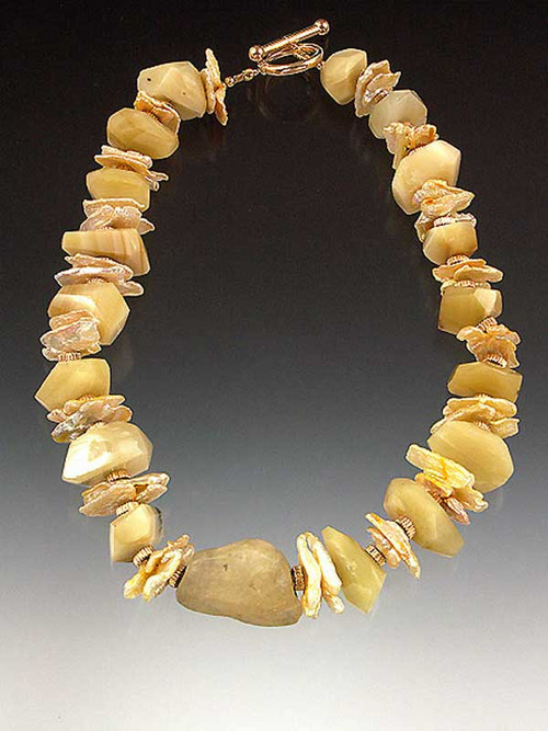 Perfectly matched nesting carnelian and tourmalated quartz squares adorn this must have piece!