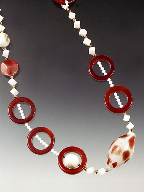 Anchors Away! Down to the sea in these necklaces featuring hand-blown Venetian glass seashells!