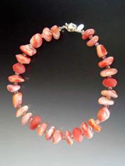 A delightful collar of pink/rose Botswana agate, cherry quartz, rose Swarovski rondels, and frosted quartz.