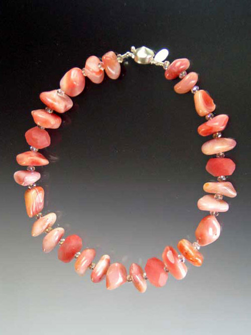 A delightful collar of pink/rose Botswana agate, cherry quartz, rose Swarovski rondels, and frosted quartz.