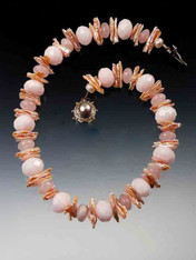 """This intricate collar is a medley of pink pastels featuring Grade AAA pale pink Brazilian opal, rose quartz, and shiny biwa pearls with a custom mabe pearl sterling clasp. 18"""""""