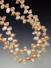A fabulous freeform raw pink pearl necklace.