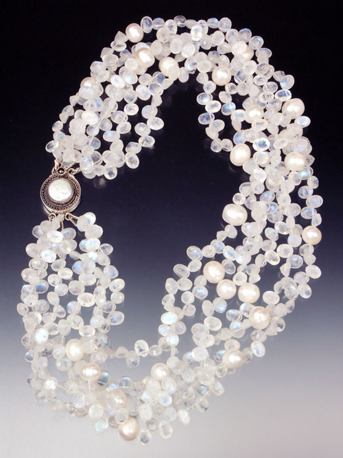"""Want a collar of white diamonds? These are just as dazzling and more interesting! 14mm white pearls float on clouds of faceted rainbow moonstone with flashes of blue and white ice. Superb quality. Only three or four strands available. 20"""""""