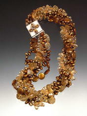 An all time bestseller and total showstopper. This magnificent torsade features several shades and shapes of citrine and gold/bronze pearls with a citrine sterling highlight clasp.  20""