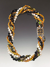 """A glamorous torsade of white and gold freshwater pearls, abalone, matte/shiny black onyx cubes with a custom citrine sterling highlight clasp. 20"""""""