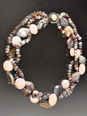 This lustrous multi-strand torsade features Botswana Agate rondels intertwined with strands of pink opal and botswana agate nuggets.  A delightful sublte medley of pink, gray, and silver tones with a rare mabe pearl sterling clasp.  21""