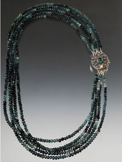 Absolutely dazzling!  Five strands of grade AA tiny faceted green tourmaline with alternating bands of color held by a dramatic sterling appatite clasp for a center or side focal point.  Note: the strands are perfectly nesting but can also be slightly twisted as in this picture.  20""