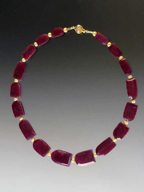 """Absolutely collectible, and fit for a queen!  Perfectly matched deep red horseshoe shaped raw rubies spaced with laser-cut 14K gold beads and a 14K clasp.  17"""""""