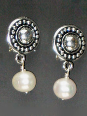Now you can have the finest quality pearl earrings in clips. This elegant design features circle pattern Terracast sterling buttons and Grade AAA perfect round milky white freshwater pearls. Super light and elegant 1""