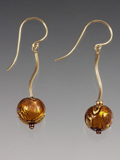 Perfect match for Golden Globe necklaces. Super elegant with lots of real gold. 24K topaz Venetian glass globes dangle from a curved 14K tube. Select 14K earwire or post and topaz (shown), red, cobalt, or aqua.