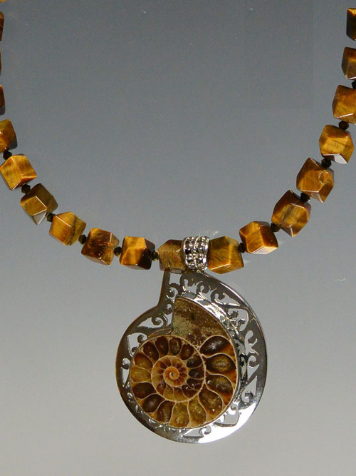 Make a statement with this faceted Tiger Eye necklace and ammonite pendant set infiligree sterling silver 19""