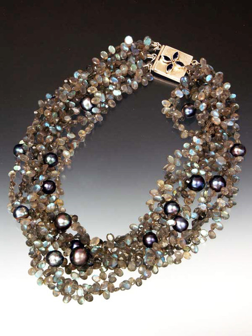 """Steal the show with 12mm freshwater black pearls on a stage of glittering grade AAA faceted labradorite ovals, finished with a custom sterling iolite clasp 20"""" Available in 4, 5, 6 strands or more."""