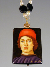 "This is definitely my favorite!  This hand-painted Russian lacquered miniature features a Botticelli portrait of a young courtier with a red hat.  The black onyx pendant (1-3/4"" x 3/4"") has been painstakingly covered with many layers of oil paint, egg tempura, gold foil, and lacquer to create the dramatic effect.  The pendant, crowned with a 14K gold rondel and 24K Swarovski crystal, hangs from a gold wire wrapped chain of white freshwater pearls and jet discs.  28"""