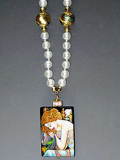 """Featuring a hand-painted Lacquered miniature is a portrait by the renowned late 19th Century Art Nouveau painter, Alphonse Mucha.  The pendant, crowned with a 14K gold rondel and 24K Swarovski crystal.  18"""""""