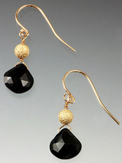 These elegant earrings feature faceted black tourmaline teardrops topped with a frosted 14K ball and 14K earwires.