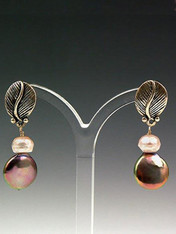 These striking earrings feature a mocha coin pearl, a pale pink pearl rondel, and a sterling silver leaf with post. 1""