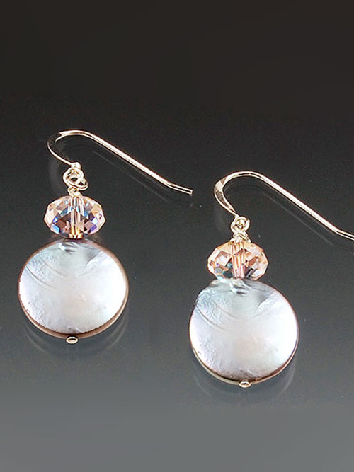 These versatile earrings match so many ensembles. 14mm Grade AA Silver coin pearls topped with Swarovski crystal donut with either 14K or sterling earwires