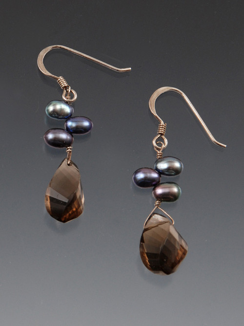 These lovely earrings feature smoky topaz faceted swirls topped with tiny peacock pearls and sterling silver earwires.  Incredibly light, versatile, and wearable.   1-1/4""