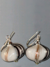 These dramatic earrings feature mocha-gray gold and black window hand-blown Sasso* Swirl beads topped with a Swaorvski sterling diamond and sterling earwires. Choose silver or gold earwires. 1""