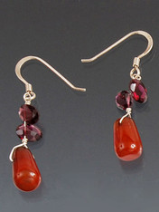 This very popular affordable design is easy to wear with everything while adding a touch of sparkle.  It features carnelian dangles topped with faceted rhodolite garnet and sterling silver earwires. 1""