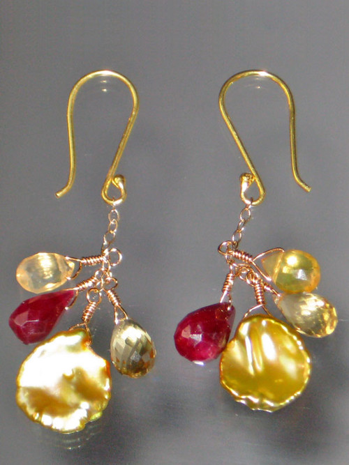 """This smashing pair of earrings features a delightful dangle of precious rubies, citrine, and golden petal pearls. 1-1/4"""""""