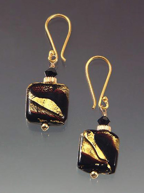 This dramatic elegant earring features a special 24K jet gold Venetian glass square, 14K rippled rings and tiny Swarovski crystals.