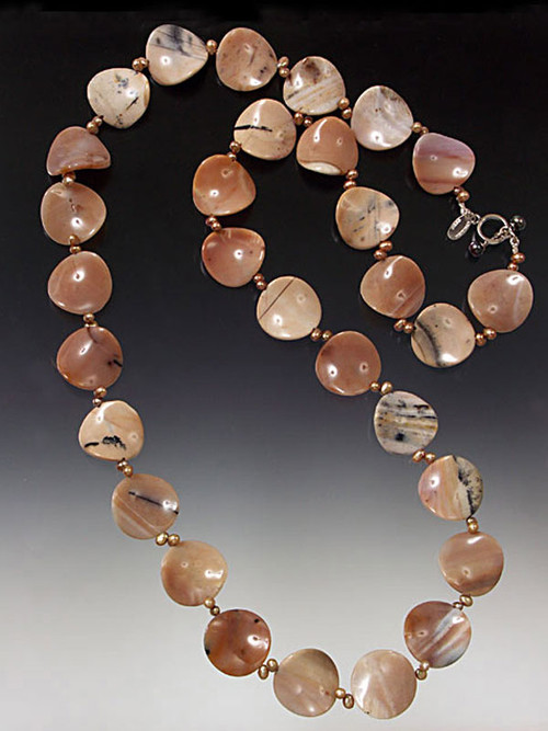 "Striking 25mm jasper discs in an unusual scalloped wave pattern with pink, grey, white and mocha highlights gives you the option of wearing one rippling 36"" rope or a two-strand collar."