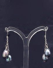 Make a dramatic statement with these double peacock pearl dangle earrings on sterling silver chain.  1-1/2""