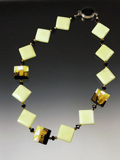 This unusual necklace features lemon chrysophrase squares with Swarovski crystals and Venetian lime, gold and white square beads. 17-1/2""