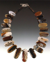A lustrous montana agate collar. Perfect for you at a great price. 19""