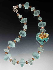 "A magnificent transparent azure Venetian glass heart with clouds of 24K and sterling silver floats on a strand of  rare matte aquamarine nuggets, grade AA finely faceted aquamarine, and cognac Swarovski crystals. Get two looks in one by reversing the heart!  19""   Last one!"