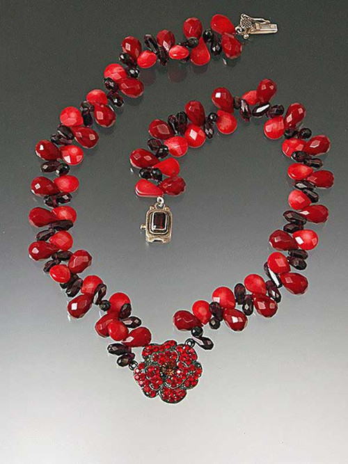 "This stunning collar features a bright red tiny stoned flower hanging from a chain of red coral, garnet, and vintage Czech glass.  18""  Only one left!"