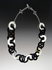 "This lightweight on-trend necklace features luminous natural Makabibi shell, black horn, and mother-of-pearl linked circles. It will become your throw on wardrobe staple that carries into all seasons. 18""sterling hook clasp with 2"" extender.  Only 6 available."