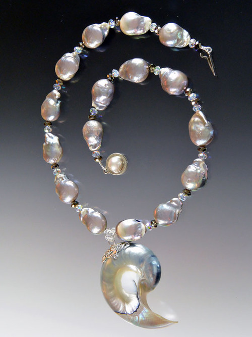 "This spectacular 20"" necklace features gleaming opulent taupe/gray baroque pearls with a magnificent 3"" pale blue and white Nautilus Shell sterling silver pendant custom ordered from Bali."