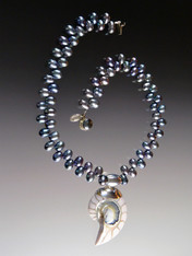 "This spectacular 20"" necklace features opulent peacock ""firecracker"" pearls with a magnificent 3"" pale blue and white Nautilus Shell sterling silver pendant custom ordered from Bali."