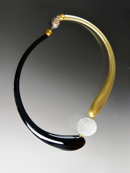 """If you like asymmetrical modern designs, this is for you! This brand new Venetian Glass Bead is extremely popular in contemporary designs in Venice and San Marco. Our dramatic asymmetrical collar features two curved blown Venetian """"boro"""" glass hollow tubes- one black, the other topaz with 24K gold, four 24K Venetian gold small beads, a bright white Brazilian Druzy disc, and a limited edition vintage sterling floral dome brass clasp. 22"""""""