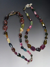 """Tourmaline has skyrocketed in price in the past few years.  I have available two strands of smooth watermelon tourmaline pubble shapes ranging from deep wine to green to strawberry each hand-knotted with silk.  19"""""""