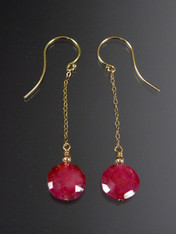 "These brilliant earrings feature grade AAA faceted ruby coins, 14K bead, chain and earwires. 1-1/2"" Only two pairs."