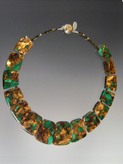 """This stunning malachite copper collar features vivid green malachite blended with copper and gold. and a vintage brass sterling silver limited edition dome clasp Totally striking and perfect for now.  18""""  No two exactly alike but each one simply beautiful."""