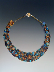 """This collar of intricately patterned copper blue sea-sediment jasper with flashes of sky blue,copper, and brown, complements your fall wardrobe and fits your neck to perfection. No two identical but all equally beautiful.18"""""""