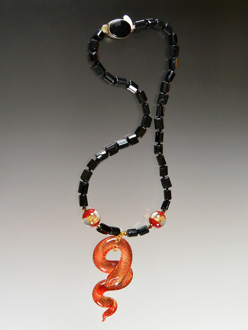 Pure drama -   spectacular necklace features natural black tourmaline, crimson Venetian window beads with 24K gold and a luxurious crimson and gold serpent dangle.