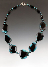 """A dramatic 17-1/2"""" collar of freeform shiny black agate with natural rims and patches of turquoise.  Spaced with Swarovski crystals,  onyx sterling clasp.  BESTSELLER! ONLY ONE LEFT!"""