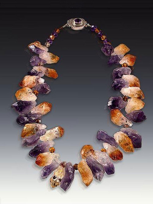 "If you like organic dimensional stones, you'll love this dramatic collar. Raw amethyst and citrine freeform clusters make a bold statement and are just right for right now. 18""  (Inquire about longer lengths)"